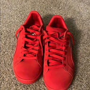 Puma red athletic shoes.